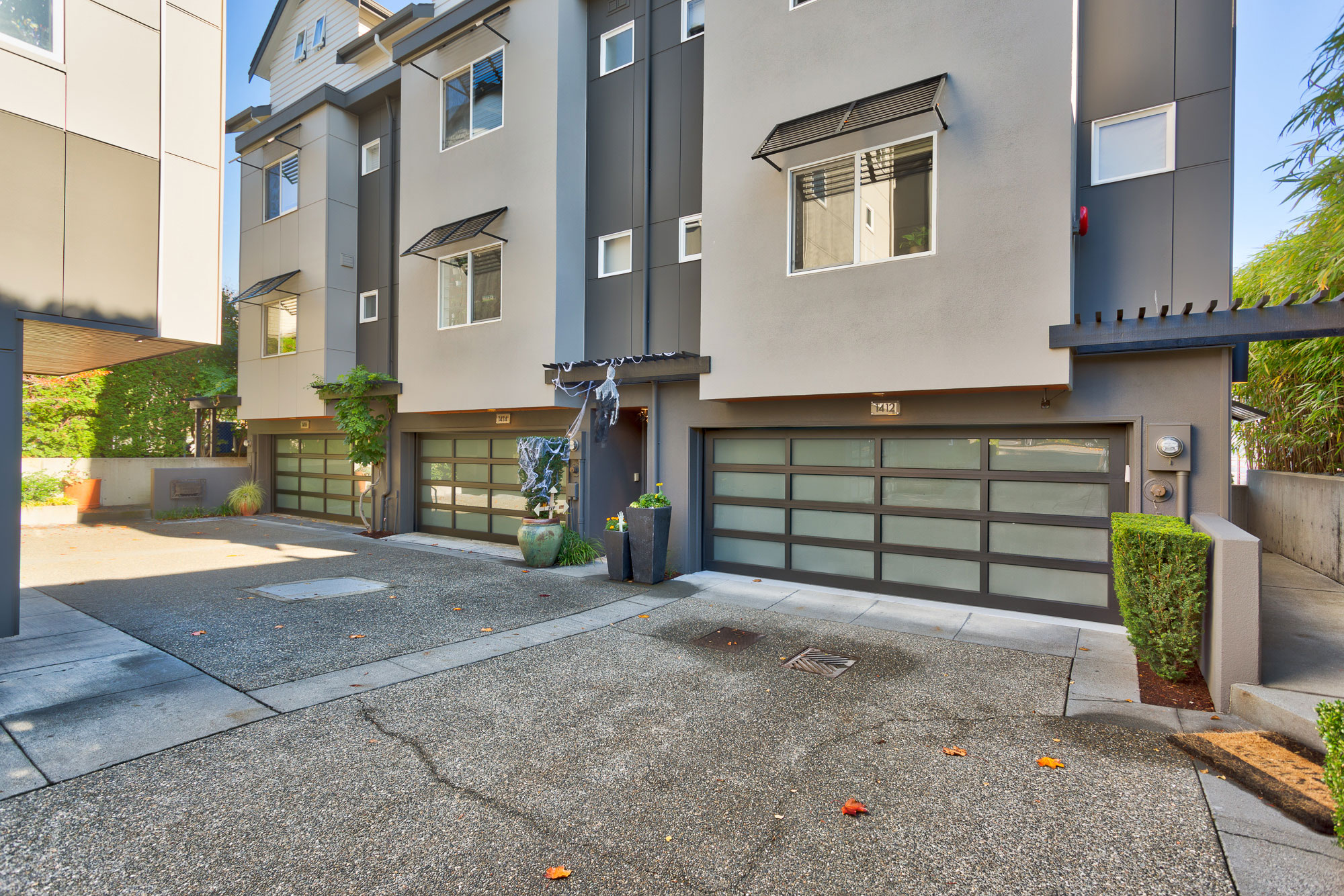 Garages of condo units with a fresh exterior created by Exterior Crew, LLC in Seattle, WA