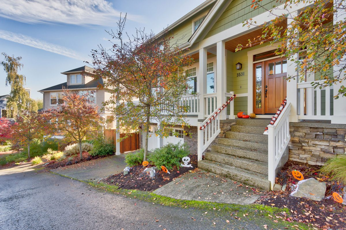 The view of a neighborhood designed by Exterior Crew, LLC in Seattle, WA from a driveway